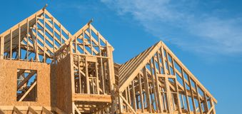 Close-up gable roof wooden house construction royalty free stock image