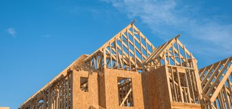 Close-up gable roof wooden house construction Stock Photography