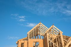 Close-up gable roof wooden house construction Stock Images