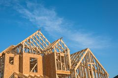 Close-up gable roof wooden house construction Stock Photo