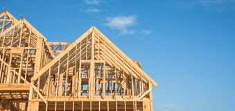 Close-up gable roof wooden house construction Stock Image