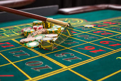 Close up of gambling chips on green table in casino. Royalty Free Stock Photos