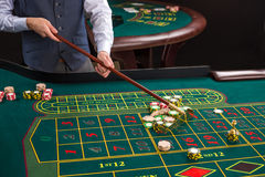 Close up of gambling chips on green table in casino. Royalty Free Stock Photo