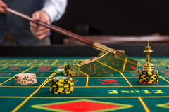 Close up of gambling chips on green table in casino. Stock Images