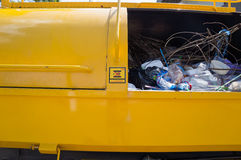 Close up garbage in garbage truck and be careful sign Royalty Free Stock Photography