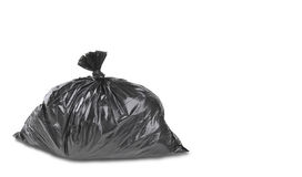 A close up of a garbage trash bag. Isolated on a white background Royalty Free Stock Photo