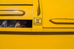 Close up garbage truck and be careful sign Stock Image