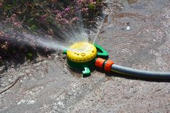 Close up on garden watering system. Water sprinkler. Close up on garden watering system. Water sprinkler in spring Royalty Free Stock Photography