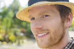 Close-up of gardener smiling while looking away Stock Photos