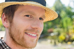 Close-up of gardener smiling while looking away Stock Photography