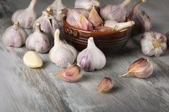 Close-up garlic bulbs and garlic cloves on wooden background. Garlic. Fresh garlic. Royalty Free Stock Images