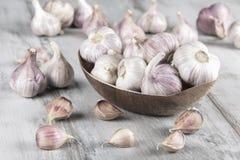 Close-up garlic bulbs and garlic cloves on wooden background. Garlic. Fresh garlic. Royalty Free Stock Photography