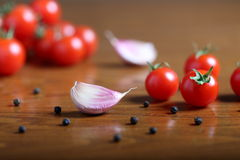 Garlic and tomato cherry Royalty Free Stock Photography