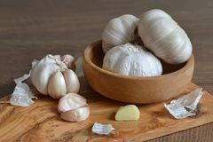 Garlic in a wooden bowl. Close up of garlic in a wooden bowl Royalty Free Stock Photo