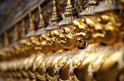 Close up of Garuda decoration on chapel base at Grand Palace. Stock Photos