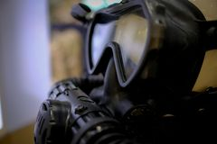 Close up of a Gas mask. Afraid apparatus army biohazard black breathe chemical concept danger defense destruction equipment face fear filter grunge  issue lens royalty free stock photography
