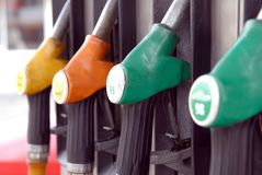 Gas pump guns in close up stock images