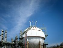 Close up of Gas storage sphere tanks and smoke stack in petroche Stock Images
