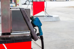Close up of gasoline hose at gas station Stock Image