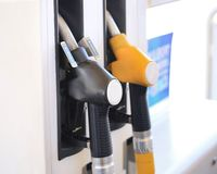 Close up gasoline station, gas pump nozzle, petrol station. Multi-colored handles two filling guns stock photos