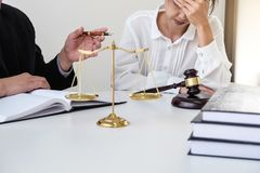 Close up of gavel, Male lawyer or judge Consult with client and. Working with Law books, report the case on table in modern office, Law and justice concept Royalty Free Stock Image