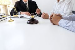 Close up of gavel, Male lawyer or judge Consult with client and. Working with Law books, report the case on table in modern office, Law and justice concept royalty free stock images