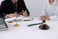 Close up of gavel, Male lawyer or judge Consult with client and. Working with Law books, report the case on table in modern office, Law and justice concept stock photos