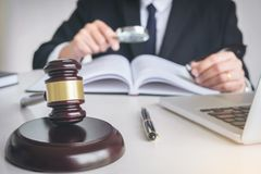 Close up of gavel, Male lawyer or judge working with Law books, Stock Photos