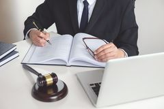 Close up of gavel, Male lawyer or judge working with Law books, Stock Photography