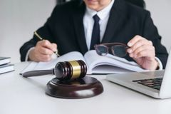 Close up of gavel, Male lawyer or judge working with Law books, Royalty Free Stock Photos