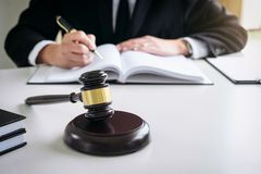Close up of gavel, Male lawyer or judge working with Law books, Royalty Free Stock Photography