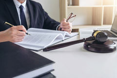 Close up of gavel, Male lawyer or judge working with Law books, Royalty Free Stock Image