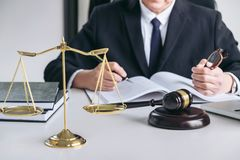 Close up of gavel, Male lawyer or judge working with scales of j Stock Photo
