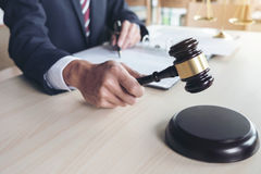 Close up of gavel, Male lawyer working with scales of justice, b Stock Photos
