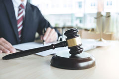 Close up of gavel, Male lawyer working with scales of justice, b Stock Photo