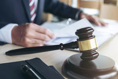 Close up of gavel, Male lawyer working with scales of justice, b Royalty Free Stock Photo