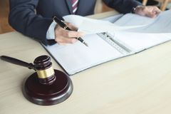 Close up of gavel, Male lawyer working with scales of justice, b Stock Photography