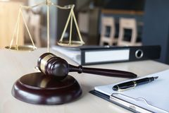 Close up of gavel and scales of justice and Report the case with Royalty Free Stock Images