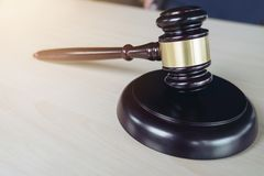 Close up of gavel on wooden table in a courtroom striking, Law a. Nd justice concept stock photos