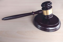 Close up of gavel on wooden table in a courtroom striking, Law a Stock Photography