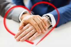 Close up of gay couple hands with wedding rings on Royalty Free Stock Photo