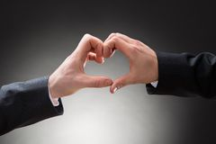 Close-up of gay men hand's making heartshape Stock Photo