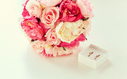 Close up of gay wedding rings and flower bunch Stock Photography