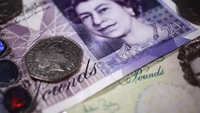 Close up of 5 and 20 GBP note stock video