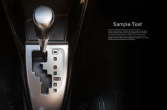 Close up gear stick interior inside bright car. Royalty Free Stock Photo