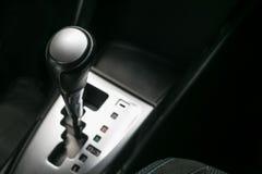 Close up gear stick interior inside bright car. Close up gear stick interior inside bright car Royalty Free Stock Photos