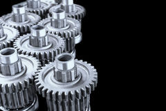 Close up gears on black Stock Images