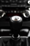 Close-up of gear stick inside a car against cockpit Stock Images