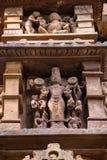 Close up genre stone carving in Lakshman Temple. Famous genre bas relieves, Lakshmana Temple, Khajuraho, India. Unesco World Heritage Site. The most famous Stock Photos