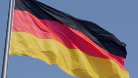 Close up of The German national flag flying in the wind together stock footage